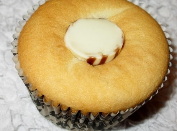 Remove form oven, immediately make a slit in center of cupcake and press in...