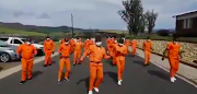 Prisoners taking part in the 'Jerusalema' dance challenge.
