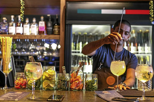 Haroon Haffajee mixes a gin-base cocktail at The Secret Gin Bar in Durban North