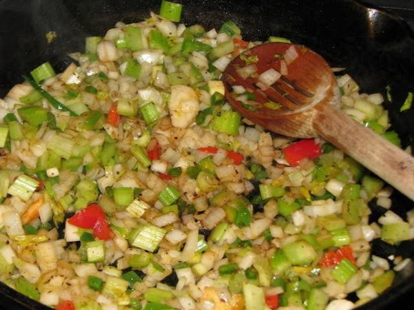 Once the meat is browned sufficiently, add the onions, celery, bell pepper, garlic and...