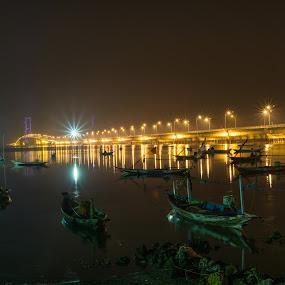 Suramadu Bridge at night by Eko Probo D Warpani - Transportation Boats ( colorful, colors, boats, sony alpha, seascape, boat, surabaya, nightscape, sony, suramadu, night photography, color, night, bridge,  )