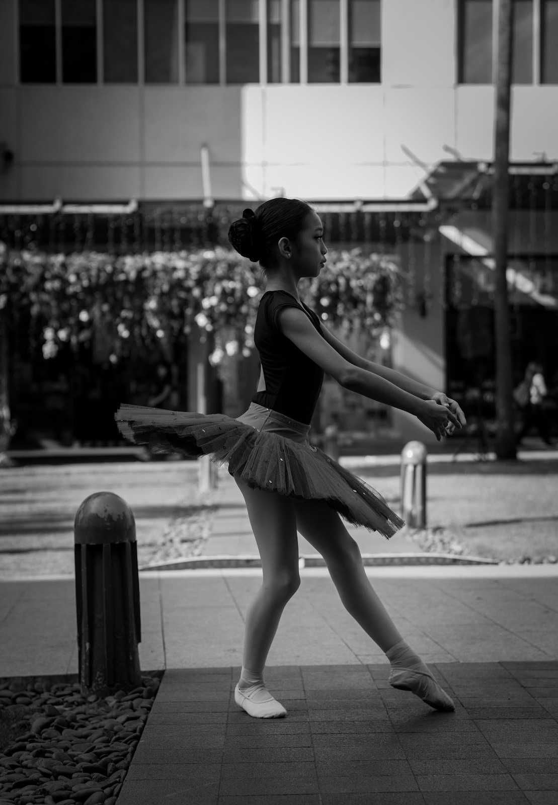 black and white image of young female dancer