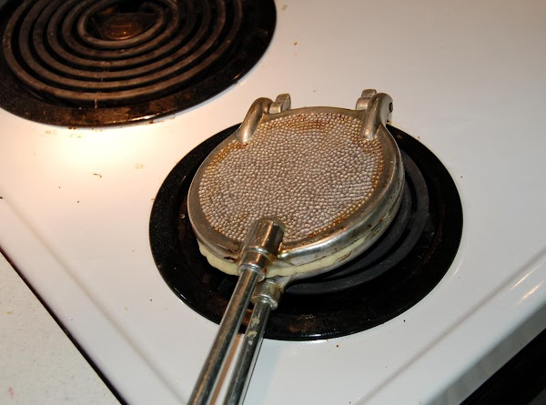 Heat pizzelle iron on med- high heat. Drop a teaspoon in the middle and...