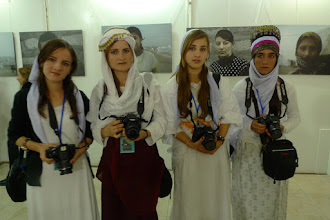 Photo: Yezidi photographers during the opening of their exhibition of Yezidi people living as refugees after the ISIS invasion on their land, Festival Gelawej, Suleymaniya, 2015