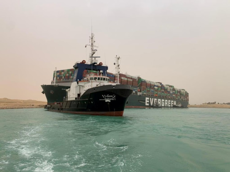 A container ship that was hit by strong wind and ran aground in Suez Canal, Egypt, on March 24 2021. Picture: SUEZ CANAL AUTHORITY/HANDOUT VIA REUTERS