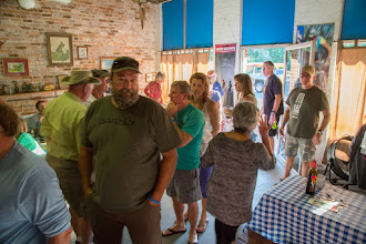 Photo: the line starts for the pot luck