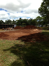 Photo: Nothing much is happening yet on our classroom building.  You can see the pile of construction trash as well as large piles of dirt from digging the fire lane.