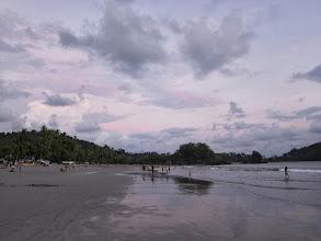 Photo: Vanessa  goes for a swim at sunset, Playa Espadilla Norte