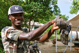Photo: Pre-germinated seeds are taken out of the ground after 24 hours (rapped in a cloth) Ferrier, Haiti, June 2010 [Photo by Erika Styger]