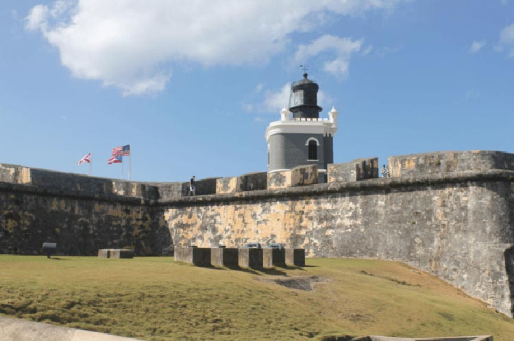 A modern tower overlooks the 16th-century battlements of El Morro in San Juan.