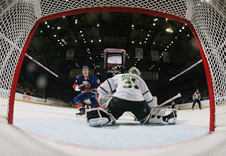 Photo: UNIONDALE, NY - DECEMBER 15: Matt Martin #17 of the New York Islanders is stopped on a first period breakaway by Richard Bachman #31 of the Dallas Stars at the Nassau Veterans Memorial Coliseum on December 15, 2011 in Uniondale, New York.  (Photo by Bruce Bennett/Getty Images)