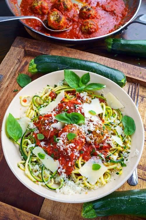 "Zucchini Turkey Meatballs in Marinara on Zoodles""Adding zucchini to ground meat, like..."