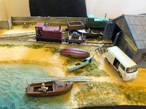 Photo: 013 In the centre section of the layout are some more boats and the start of the ephemera that one would find at a small boat yard. Both the diesel locos in this photo are ex-RNAD Hunslets that are 3D print bodies from Chris Ward mounted on Kato tram chassis .