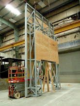Photo: Lincoln entry portal framework with plywood being attached as a substrate for the aluminum composite wall panels.