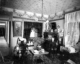 Photo: 1904 parlor. Note that as in bedrooms, the parlors also tend to have simple curtains and shades. The heavy draperies that we associate with the 19th c were huge dust and dirt catchers and hard to keep clean. Most housewives, when faced with the choice of high fashion or cleanliness often opted for the latter. With time the heavier draperies began to vanish altogether.