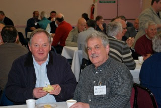 Photo: Robert Ditty, Sponsor, Master Baker and Conference delegate enjoying one of his own scones with another delegate.