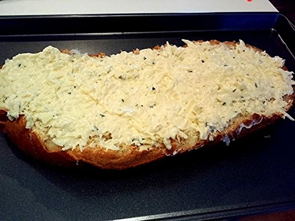 Preheat oven to 350 degree F.In a medium bowl, mix together the mozzarella cheese,...