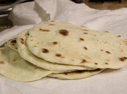 Warm 1 Flour Tortilla and set aside