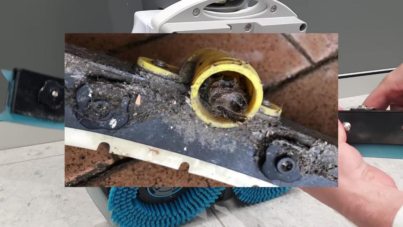 A blocked squeegee  off an i-mop xl floor scrubber