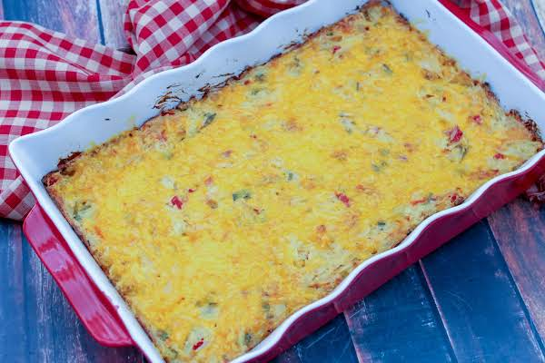 Creole Hash Brown Casserole With Melted Cheese.