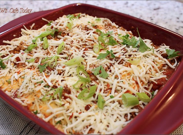 Cover dish loosely with non-stick aluminum foil, place dish on a baking sheet and...