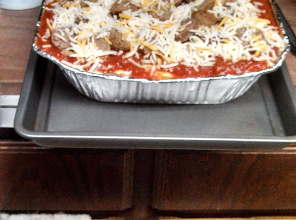 Preheat oven to 350, place one aluminum pan on a cookie sheet for stability....