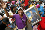 Supporters of church leader Shepherd Bushiri pray outside the Pretoria Specialised Commercial Crimes Court where he appeared on Monday.