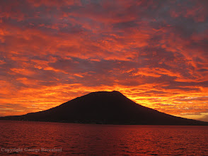 Photo: Island of Ternate, Indonesia at sunset in 2012. Copyright George Beccaloni