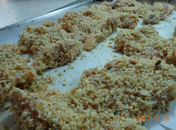 Rub chicken thighs on both sides with yogurt mix.  Place bread crumbs in...