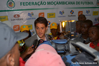 Photo: Coach McKinstry is mobbed by Mozambique press after defeating Mozambique 1-0  in opening AFCON2017 Qualifier. [Rwanda Amavubi v Mozambique 14 June 2015 (Pic © Darren McKinstry / www.johnnymckinstry.com)]