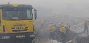 Firefighters try to douse a blaze at a landfill site in Pietermaritzburg.