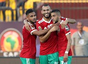 Morocco's Khalid Boutaib and Hakim Ziyech celebrate after Namibia's Itamunua Keimuine scored an own goal during their opening Group D match at Cairo's Al Salam Stadium on June 23 2019.