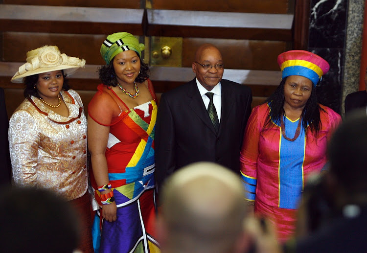 Jacob Zuma poses for photographs with his three wives Sizakele Khumalo, Nompumelo Ntuli and Thobeka Madiba.