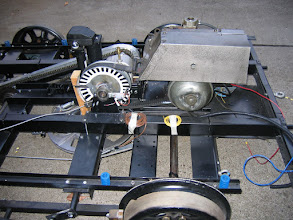 """Photo: Example of an electronic transmission speed detector. Note the white and black marks on the driven clutch. These are read by an """"electronic eye"""". An LED in the circuit, mounted on the control panel, flashes """"on an off"""" as the white and black marks move past the electronic eye. When the flashing stops, so has the driven clutch. This is a Tamper Motorcar owned by Rob Baur  pearbaron@msn.com  who lives in Oregon.  Photo courtesy of Rob Baur."""