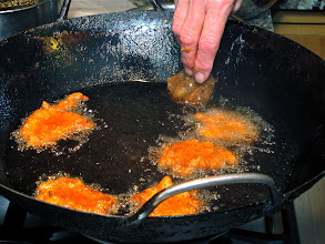 Photo: dropping the spiced shrimp mixture in small patties into the hot oil