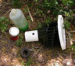Photo: Collapsed Lindgren funnel trap w/ wire, alcohol and antifreeze
