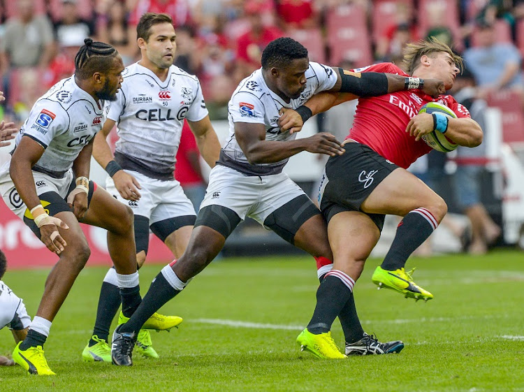 Sharks clash against the Lions during the Super Rugby at Ellis Park.