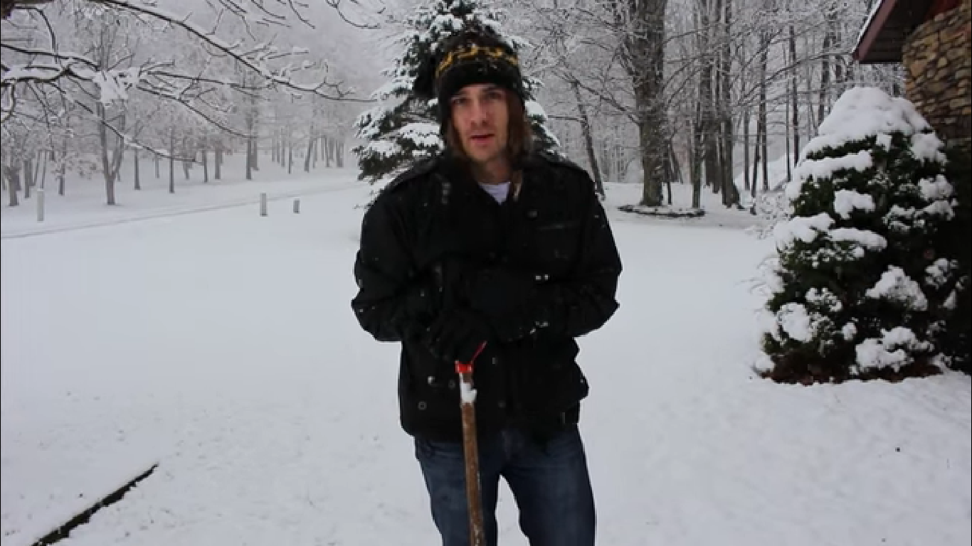 Man Removes Snow From Lawn Without A Shovel By Rolling It Like A Carpet