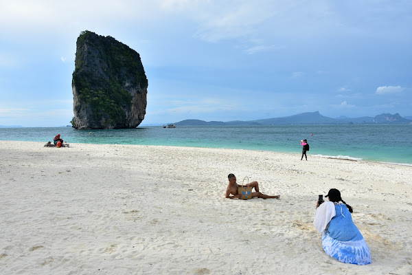 Sunbath and swim at the white sandy beach of Poda Island