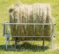 cradle hay feeder with a large bale in it