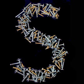 S for Screws by Janna Morrison - Typography Single Letters ( letter s made out of screws )