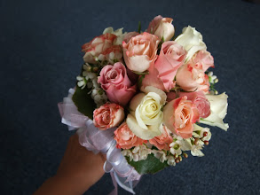 Photo: [B13]Hand tied bouquet with full stem wrap of white and pink roses, with peach spray roses and accented with white waxflower, and galax leaves