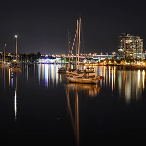 Waterscape by Cory Bohnenkamp - City,  Street & Park  Night ( water, boats, dark, reflections, night, boat, city )