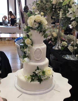 traditional all white 4 tiered wedding cake