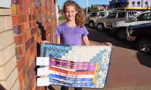 2018 Narrabri Show needlework grand champion, 13-year-old Erin Flower with the quilt she made for the competition.