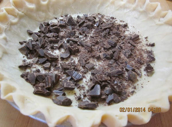 Sprinkle the chocolate on the bottom of the crust. Gently pour the filling over...