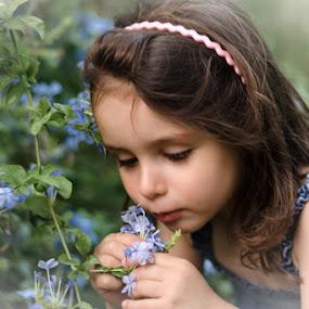 A little fairy by Elias Spiliotis - Babies & Children Child Portraits ( girl, smelling, blue, green, little, candit, flowers, garden, portrait )