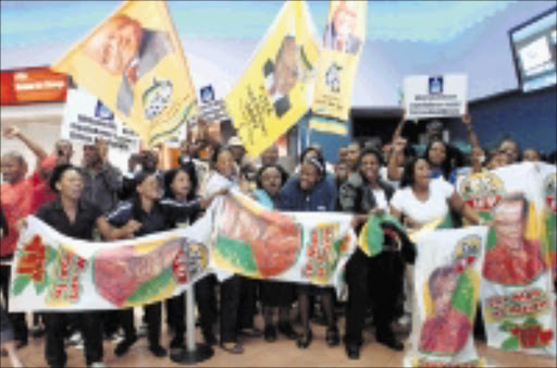 UNITED IN VICTORY: ANC and IFP members jointly welcome MTN8 Cup champions Lamontville Golden Arrows at Durban International Airport. Pic: SIYABONGA MOSUNKUTU. 02/11/2009. © Sowetan.