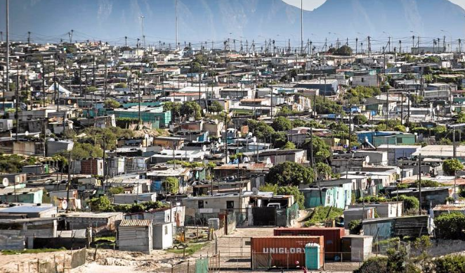 Children play on a small ball court in the informal settlement of Indlovu, in Khayelitsha, Cape Town. Picture: DAVID HARRISON