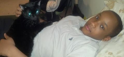 Photo: Jihad pets Osiris